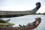 Phil McLarnan, cq, Humboldt, Iowa, rides in the stern of a Dragon Boat as it is launched into...