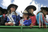 Rodeo queens and princesses were herded into a wagon and then paraded around the rodeo grounds for...