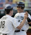 PPS101 - Florida Marlins' Miguel Cabrera, right, is greeted by Jeff Conine (18) after both scored...