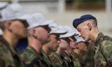 (Lt. to Rt.) Basic Cadet Trainees are inspected by Cadet 1st Class Daniel Wilkenson (CQ) during...