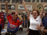 Owner Joe Amato (cq), left, and Charlotte Lucas (cq), right, cheer as Morgan Lucas wins in the...
