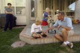 DeWayne Durham (cq), right, spends time with his family at their Westminster home Wednesday, July...