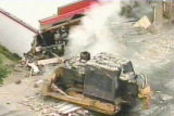 A man in an makeshift, armor-plated bulldozer crashes into a department store in Granby, Colo., in...