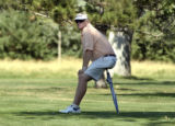 Pro golfer Mark Wiebe watches his son Gunner play in the Colorado Golf Association's Junior Stroke...