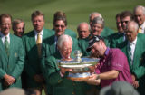 Jack Vickers, left, hands the trophy to Rod Pamplin after Pamplin won The International with a...
