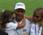 Tom Pernice's daugher, Brooke, 6,  left, feels her father Tom's face after he won The...