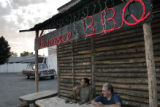 Tennessee Hickory Smoked BBQ owner Tennessee Mayhew, cq, with employee Tonie Jackson, cq, left,...