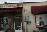 Tennessee Hickory Smoked BBQ owner Tennessee Mayhew, cq, brings in a stack ofr rib slabs after...