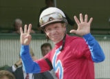 NY157 - ** FILE ** Pat Day holds up eight fingers in the Churchill Downs winner's circle after...