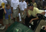 Professional golfer Sergio Garcia waits to be taken to the clubhouse after finishing his Pro-Am...