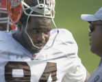 Cleveland Browns Gerard Warren talks with defensive line coach Andre Patterson during practice at...