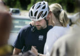 33 year old Tory Lowery (cq) is hugged by his wife Renee Lowery (cq) (rt) Tuesday morning August...