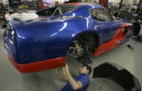 JPM823 - Mechanic fabricator Justin Taylor (cq) repairs the rear of race driver Tim Weins' Dodge...