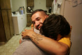 Sgt. Juan Polino, left, cq, a member of Fort Carson's 3rd ACR, hugs his brother Ramon, cq, 10, in...