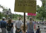 Kennan Weekley, 4, participates in a protest against congressman Tancredo's comments last week...