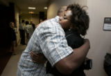 Rhonda Fields (cq), right, mother of Javad Marshall-Fields, hugs Alan Baxter (cq), right, uncle of...