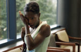 LaToya Ray (cq), wife of Robert Ray, cries in the hallway during a break in a bond hearing for...