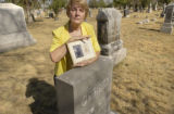 Janice Rhody Allan (cq),68, stands in Riverside Cemetery holding a picture of her great...