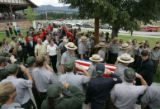 The casket of Jeffrey Allen Christensen leads a procession of family and friends while numerous...
