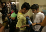 Sergio Alfaro (cq), 11, left, a 6th grader, and his cousin Yimi Serrano (cq), 11, a 5th grader,...