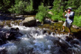 Spense Havlick (cq), 70, of Boulder untagles his line while flyfishing in a mountain stream in the...