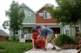 Denver, Colo., photo taken June 27, 2004- David Teter (right),6, spends a Sunday afternoon...
