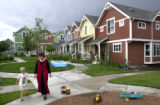Denver, Colo., photo taken June 27, 2004- David Teter (left),6, walks with his mother Kellie Teter...