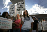 Rhiannon Willis, cq, 15, left, in pink, and Jackie Cotter, cq, 17, Parker, center, join other...