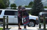 Nicole Clemings(cq), left, hugs her grandmother (WOULD NOT GIVE NAME) during a memorial service...