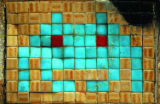 Space Invader art, with its blocky designs, is easy to reproduce with tiles.