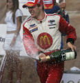 JPM0307 - Newman/Haas Racing driver Sebastien Bourdais, of France, sprays champagne on the crowd...