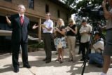 New CU President Hank Brown (far left) speaks to the media during a press conference in front of...