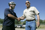 33 year old Tory Lowery (cq) says thanks and shakes hands with Alpine Rescue member Bill Barwick...