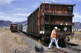 Brian Pals (cq) with MHF (owner of the rail cars) inspects more than 60 rail cars loaded with low...