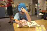 Connor Gotchall,7, blue ballcap with hand on hat, goes into deep concentration trying to sound out...