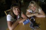 (DENVER, Colo., June 21, 2004)  Kim Painter and Nadia Shokohi (CQ Shokohi) (lt.-rt.) in their...
