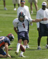 FILE-Denver Broncos' kicker, 1, Jason Elam, right, practice field goals as punter, 10, Todd...