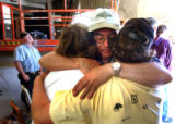 (GRANBY, CO., JUNE 7, 2004) (Foreground center then LT. TO RT.) Granby Mayor Ted Wang, comforts...