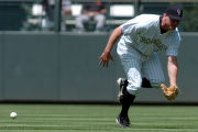 {DENVER, COLO., JUNE 7, 2004}--  Colorado Rockies outfielder, #35, Jeromy Burnitz miss judges a...