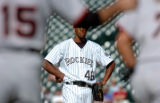 {DENVER, COLO., JUNE 7, 2004}--  , Colorado Rockies pitcher, #48, Marc Kroon, center, watches as...