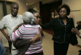 Maisha Pollard (cq), 26, sister of Javad Marshall-Fields, hugs Barbara Green, left, aunt of Javad...