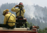 Wildland Firefighters from the Carbondale Fire Protection district (L-R)  Garrett Kennedy (cq) and...