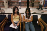 Morgan Ortega(cq), 18, left, waits to enroll for classes at Metro State College with her sister,...