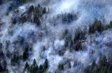 (Jefferson County, CO., June 7, 2004)   Smoke from the Trapper Mountain Fire near Deer Creek...
