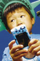 (NYT12) NEW YORK -- July 2, 2003 -- CIR-CAMERA-PHONES -- More and more cell phones can take a...