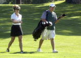 Vincenzo Artino ,17, is one of 45 caddies working at the  Lakewood Country Club on July 12, 2005....