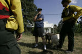 Homeowner Michael Hayes talks to firefighters from Parker Fire District outside of his house on...