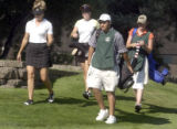 L to R: Golfers Janene Guzowski and Tracey Blake are helped by caddies Vincenzo Artino and Leigh...