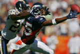 Denver Broncos wide receiver Ashley Lelie stretches for a pass from quarterback Jake Plummer on...