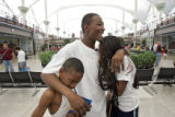 Hurricane Katrina evacuee Cash Smith (cq), 24, of New Orleans and his two kids were reunited with...